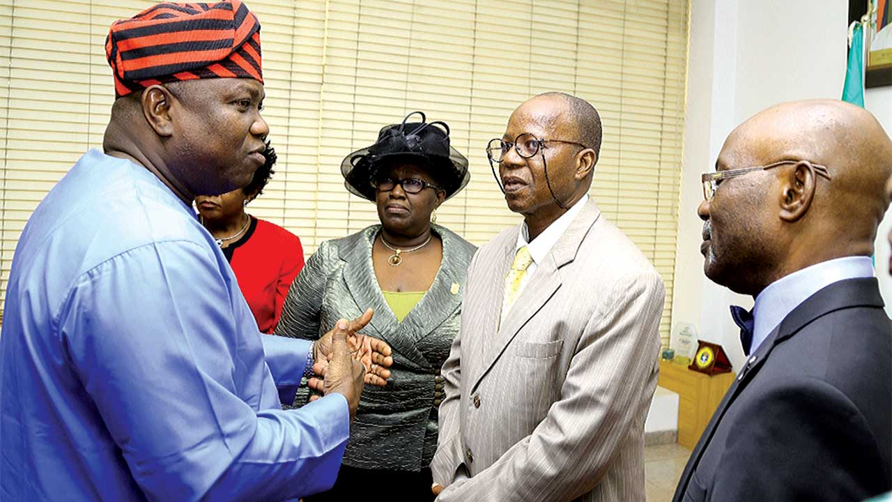Lagos State Governor, Mr. Akinwunmi Ambode (left),  with members of the newly inaugurated Committee on Restructuring of the State Building Control Agency (LSBCA):  Mrs. Yetunde Ajayi, an architect; the Chairman, Dr. Bunmi Ajayi and Oreoluwa Fadayomi, an engineer at the Lagos House, Ikeja …on Wednesday