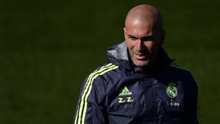 Real Madrid's French head coach Zinedine Zidane looks on during a training session at Valdebebas Sport City in Madrid on March 1, 2016. / AFP / PIERRE-PHILIPPE MARCOU