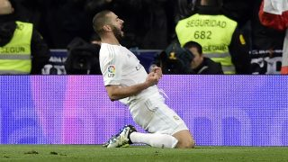 Real Madrid's French forward Karim Benzema celebrates after scoring a goal during the Spanish league football match Real Madrid CF vs Villarreal CF at the Santiago Bernabeu stadium in Madrid on April 20, 2016. / AFP PHOTO / JAVIER SORIANO