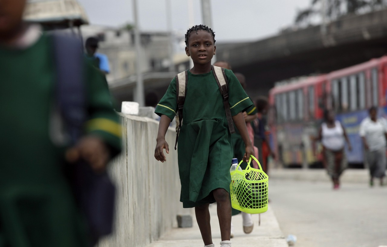 PHOTOS: AP Photo/Sunday Alamba