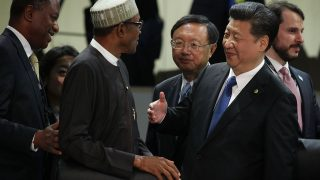 Chinese President Xi Jinping (R) greets President of Nigeria Muhammadu Buhari (L) during a plenary session of the 2016 Nuclear Security Summit April 1, 2016 in Washington, DC. U.S. President Barack Obama is hosting the fourth and final in a series of summits to highlight accomplishments and make new commitments towards reducing the threat of nuclear terrorism.   Alex Wong/Getty Images/AFP