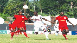 Abia Warriors' Stanley 'Little Messi' Okoro (left) and Michael Olaha sandwich FC IfeanyiUbah's Elu Wilson during an NPFL game  PHOTO: LMC.