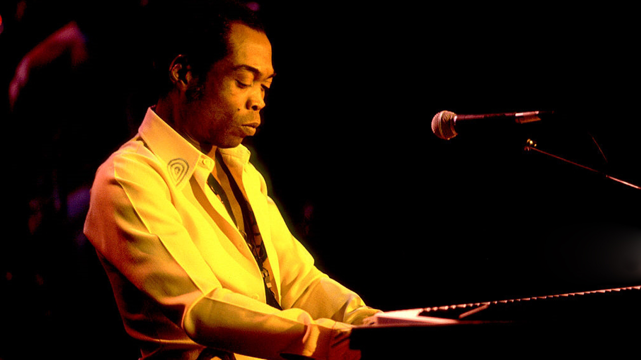 Fela Kuti performs onstage at the Riviera Theater, Chicago, Illinois, November 13, 1986. PHOTO: PAUL NATKIN/Getty Images)