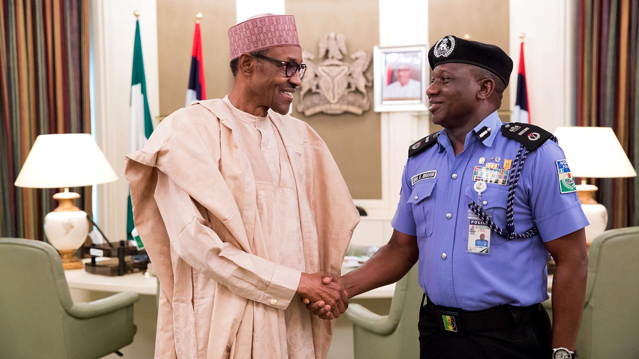 New Acting Inspector General of Police Mr Ibrahim Kpotun Idris right being Congratulated by President Muhammadu Buhari at the State House Abuja June 21, 2016. PHOTO: PHILIP OJISUA
