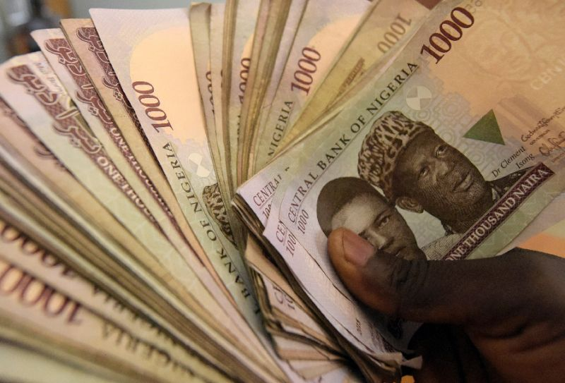 Nigeria's black market naira nears central bank rate for consumers -traders