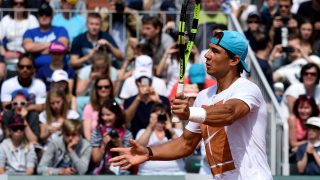 (FILES) This file photo taken on May 21, 2016 shows Spain's Rafael Nadal wearing a bandage on his left wrist as he takes part in a training session ahead of the French tennis Open on May 21, 2016 at Roland Garros stadium in Paris. Nine-time champion Rafael Nadal sensationally quit the French Open with a left wrist injury today as Andy Murray cruised into the last-16. Nadal, 29, stunned Roland Garros by calling a news conference at just 10 minutes notice to announce he was pulling out. The Spaniard said he had been playing with an anesthetic injection in the wrist in the first two rounds and that MRI scans had shown that the injury was getting worse.  / AFP PHOTO / ERIC FEFERBERG