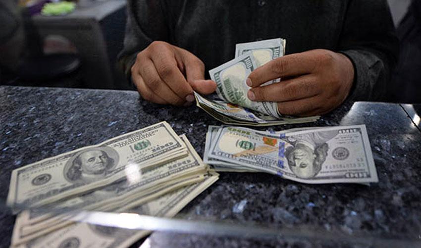 US dollar.AFP PHOTO/Aamir QURESHI