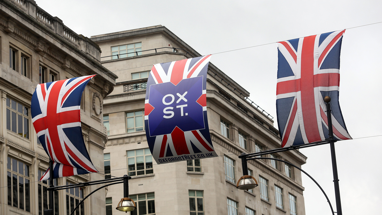British Union flags, also known as a Union Jack, hang between buildings on Oxford Street in London, U.K., on Friday, July 8, 2016. U.K. retailers had their worst June in a decade as consumers reined in spending ahead of the country's European Union referendum, according to figures from accounting firm BDO. Photographer: Chris Ratcliffe/Bloomberg via Getty Images