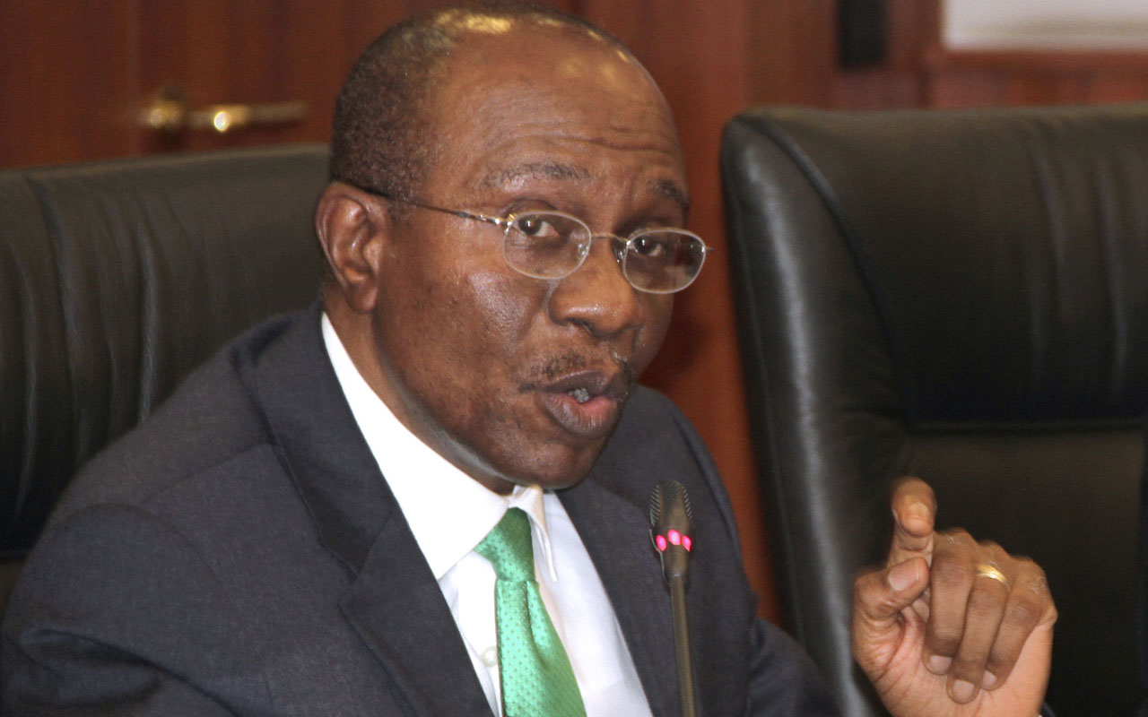 Central Bank of Nigeria's (CBN) governor Godwin Emefiele. / AFP PHOTO / PHILIP OJISUA