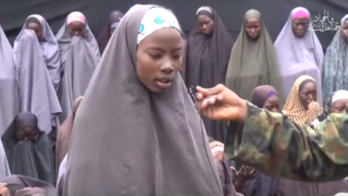 A screenshot of the video released by Boko Haram shows Esther Yakubu speaking into a tiny microphone. The Chibok Girls were kidnapped from their school on April 14, 2014.