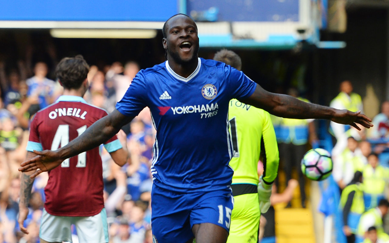 Chelsea's Nigerian midfielder Victor Moses celebrates after scoring during the English Premier League football match between Chelsea and Burnley at Stamford Bridge in London on August 27, 2016. / AFP PHOTO / GLYN KIRK /