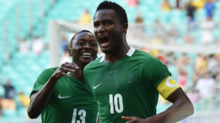 John Obi Mikel (R) of Nigeria celebrates his goal scored against Denmark during the Rio 2016 Olympic Games men's quarter-final football match Nigeria vs Denmark, at the Arena Fonte Nova Stadium in Salvador, Brazil on August 13, 2016  NELSON ALMEIDA / AFP