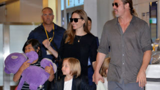 (FILES) This file photo taken on July 28, 2013 shows US film stars Brad Pitt (R) and Angelina Jolie (C), accompanied by their children,as they  arrive at Haneda International Airport in Tokyo. Brad Pitt is under investigation by US authorities after being accused of physically and verbally abusing his children during an angry outburst, TMZ reported September 22, 2016. According to the entertainment news site the Los Angeles Police Department began probing Pitt based on an anonymous tip received by the LA County Department of Children and Family Services, as is systematic following any report of child abuse. / AFP PHOTO / Yoshikazu TSUNO