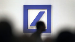 (FILES) This file photo taken on May 19, 2016 shows the logo of Germany's biggest lender Deutsche Bank during the company's annual shareholders' meeting in Frankfurt am Main, western Germany, on May 19, 2016. Shares in German lender Deutsche Bank plunged in Frankfurt on September 16, 2016 on news that US authorities were seeking a record $14 billion fine, opening 8 percent lower. / AFP PHOTO / DANIEL ROLAND