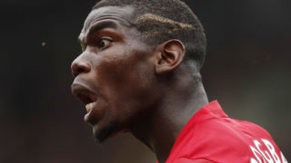 Manchester United's French midfielder Paul Pogba shouts at the linesman during the English Premier League football match between Watford and Manchester United at Vicarage Road Stadium in Watford, north of London on September 18, 2016. / AFP PHOTO / Adrian DENNIS /