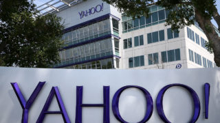 """(FILES) This file photo taken on May 23, 2014 shows a sign in front of the Yahoo! headquarters in Sunnyvale.  Yahoo said September 22, 2016 a massive attack on its network in 2014 accessed data from at least 500 million users and may have been """"state sponsored."""" """"Based on the ongoing investigation, Yahoo believes that information associated with at least 500 million user accounts was stolen,"""" a statement from the US Internet giant. / AFP PHOTO / GETTY IMAGES NORTH AMERICA / JUSTIN SULLIVAN"""