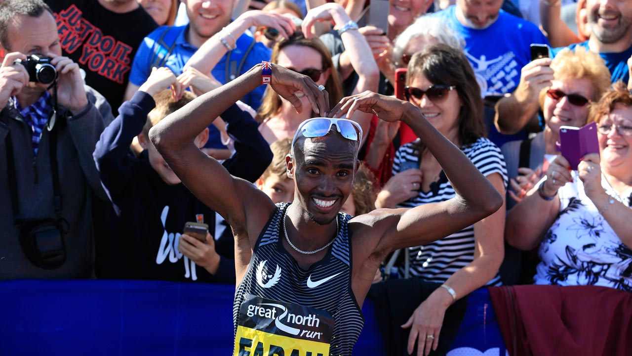 Britain's Mo Farah does his 'mobot' celebration after winning the men's elite race in the Great North Run half-marathon in South Shields, north east England on September 11, 2016. The Great North Run is Britain's largest running event with more than 50,000 participants set to cover the 13.1 miles from Newcastle to South Shields. PHOTO: Lindsey PARNABY / AFP