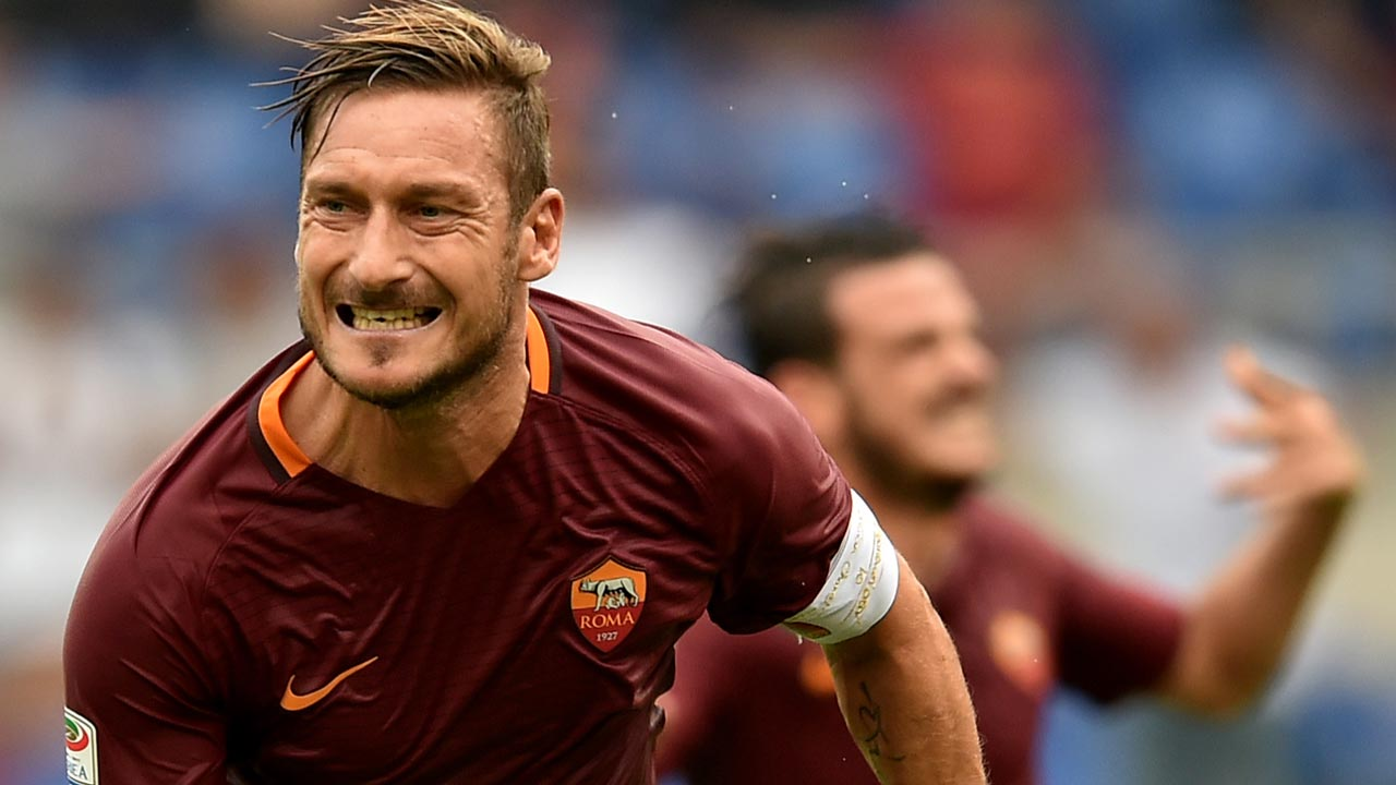 totti saves roma as england keeper suffers debut heart
