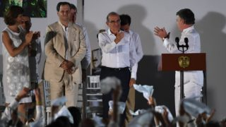 """Colombian President Juan Manuel Santos (R) looks at the head of the Colombian government's delegation of the peace talks with the FARC guerrillas, Humberto de la Calle (2-R) after delivering a speech after signing the historic peace agreement between the Colombian government and the Revolutionary Armed Forces of Colombia (FARC), in Cartagena, Colombia, on September 26, 2016 The Colombian government and the leftist FARC rebel force signed a historic peace accord to end a half-century conflict that has killed hundreds of thousands of people. Santos and """"Timochenko"""" Jimenez, signed the deal at a ceremony in the Caribbean city of Cartagena, prompting loud cheers from the crowd which included numerous international dignitaries.  Luis ACOSTA / AFP"""