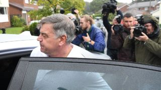 "Former England national football team manager Sam Allardyce walks out of his home in Bolton on September 28, 2016. Sam Allardyce admitted an ""error of judgment"" today after his career as England manager came to a humiliating end following controversial comments made to undercover reporters. PAUL ELLIS / AFP"