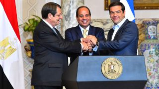 A handout picture released by the Egyptian Presidency on October 11, 2016 shows Egypt's President Abdel Fattah al-Sisi (C) shaking hands with Cyprus' President Nicos Anastasiades (L) and Greek Prime Minister Alexis Tsipras at the presidential palace in Cairo on October 11, 2016.  HO / EGYPTIAN PRESIDENCY / AFP