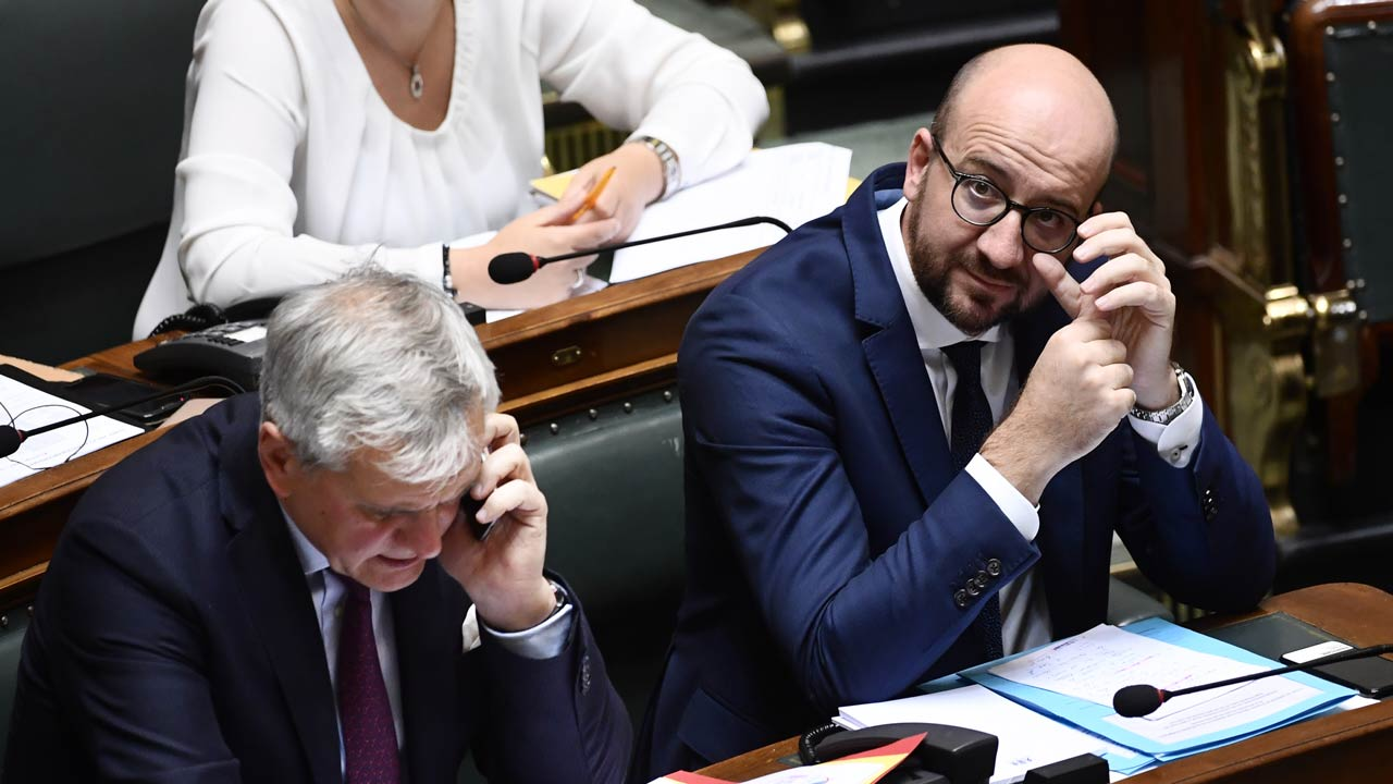 Vice-Prime Minister and Minister of Employment, Economy and Consumer Affairs Kris Peeters (L) and Belgian Prime Minister Charles Michel attend a plenary session of the Chamber at the federal parliament in Brussels on October 13, 2016. DIRK WAEM / BELGA / AFP