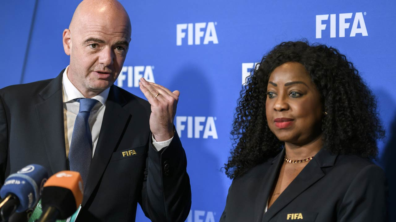 FIFA president Gianni Infantino (L) gestures next to FIFA Secretary General Fatma Samoura during a press briefing on October 13, 2016 at the world football's governing body headquarters in Zurich. FIFA president Gianni Infantino's plan to expand the World Cup faces a key test from on October 13 at a meeting of world football's top executives. Infantino wants to expand the tournament to 48 teams, a contentious move that critics say would dilute the quality of World Cup competition and add new fixtures to football's already packed calendar. FABRICE COFFRINI / AFP