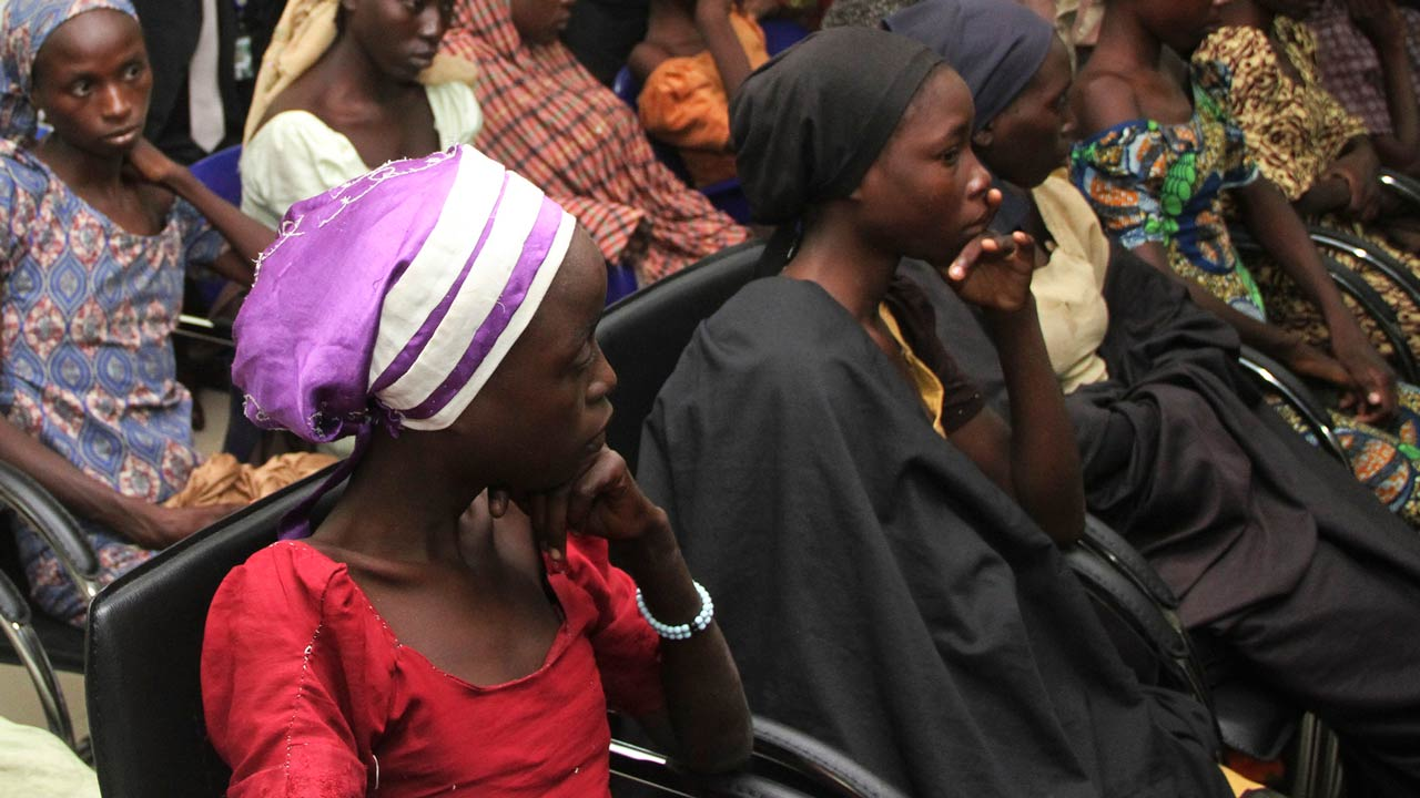 Some of the 21 freed Chibok girls are received at the Nigerian Vice President office in Abuja on October 13, 2016. Jihadist group Boko Haram has freed 21 of the more than 200 Chibok schoolgirls kidnapped more than two years ago, raising hopes for the release of the others, officials said Thursday. Local sources said their release was part of a prisoner swap with the Nigerian government, but the authorities denied doing a deal with Boko Haram. PHOTO: PHILIP OJISUA / AFP