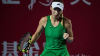 Denmark's Caroline Wozniacki celebrates winning a point against China's Wang Qiang during their women's singles quarter-final match at the Hong Kong Open tennis tournament on October 14, 2016.  DALE DE LA REY / AFP