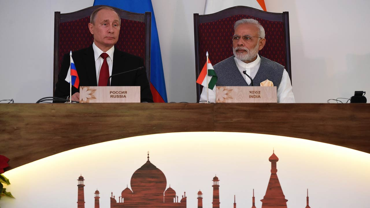 Russia's President Vladimir Putin (L) and Prime Minister Narendra Modi look on during the exchange of agreements and joint press statements ceremony during the Indo-Russia Annual Summit at Taj Exotica hotel in Goa on October 15, 2016. Indian Prime Minister Narendra Modi and Russian President Vladimir Putin signed lucative defence and energy pacts following talks aimed at reinvigorating ties between the former Cold-War allies. PRAKASH SINGH / AFP