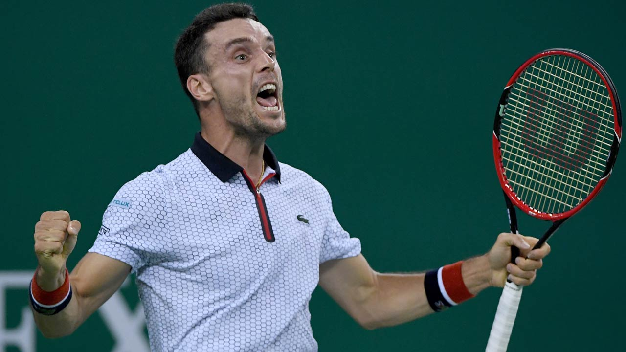 Roberto Bautista Agut of Spain celebrates after winning against Novak Djokovic of Serbia during their men's singles semifinals match at the Shanghai Masters tennis tournament in Shanghai on October 15, 2016. WANG ZHAO / AFP