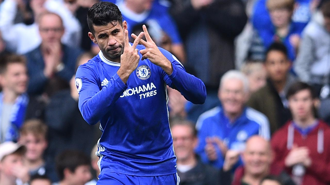 Chelsea's Brazilian-born Spanish striker Diego Costa celebrates with a gesture in support of Willian, who's mother passed away recently, after scoring the opening goal of the English Premier League football match between Chelsea and Leicester City at Stamford Bridge in London on October 15, 2016. PHOTO: Glyn KIRK / AFP