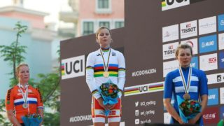 (From L to R) The Netherlands' silver medallist Kirsten Wild, Denmark's gold medallist Amalie Dideriksen and Finland's bronze medallist Lotta Lepisto stand on the podium at the end of the women's elite road race event as part of the 2016 UCI Road World Championships on October 15, 2016, in the Qatari capital Doha.  KHALED DESOUKI / AFP