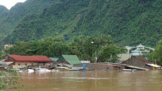 Submerged homes are seen in Bo Trach district of the central Vietnamese province of Quang Binh on October 15, 2016. At least 11 people have died with several more missing in heavy flooding in central Vietnam, state media said on October 15, 2016, with tens of thounsands of homes completely submerged by water. VIETNAM NEWS AGENCY / AFP