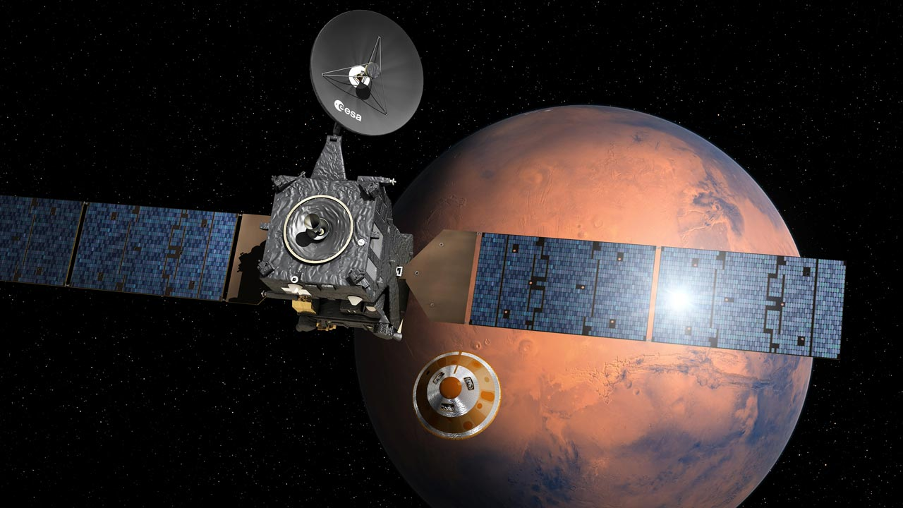 (FILES) This file photo handout photo taken from the European Space Agency website on March 1, 2016 shows an artist's impression depicting the separation of the ExoMars 2016 entry, descent and landing demonstrator module, named Schiaparelli, from the Trace Gas Orbiter, and heading for Mars. Europe's Schiaparelli Mars lander is set to separate from its mothership on October 16, 2016 for a three-day, one million-kilometre (621,000-mile) descent to the Red Planet's surface to test landing gear for a future rover. D. Ducros / EUROPEAN SPACE AGENCY / AFP