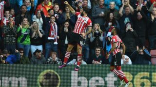 Southampton's English striker Charlie Austin (L) celebrates after scoring the opening goal of the English Premier League football match between Southampton and Burnley at St Mary's Stadium in Southampton, southern England on October 16, 2016.  Glyn KIRK / AFP