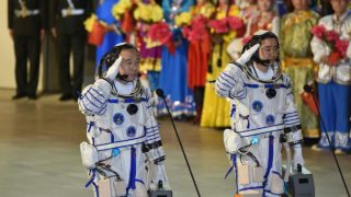 Chinese astronauts Jing Haipeng (L) and Chen Dong salute during the send-off ceremony of the Shenzhou-11 manned space mission at the Jiuquan Satellite Launch Center in Jiuquan, northwestern China's Gansu Province on October 17, 2016. China launched two astronauts into space on October 17, official media said, on a mission to its orbiting laboratory as the country works towards setting up its own space station. STR / AFP