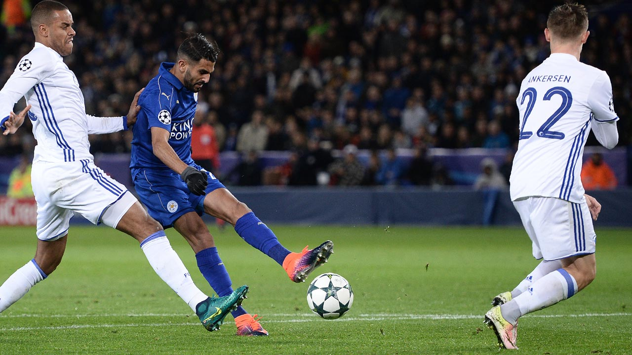Leicester City's Algerian midfielder Riyad Mahrez (C) attempts a shot on goal during the UEFA Champions League group G football match between Leicester City and FC Copenhagen at the King Power Stadium in Leicester, central England on October 18, 2016. OLI SCARFF / AFP
