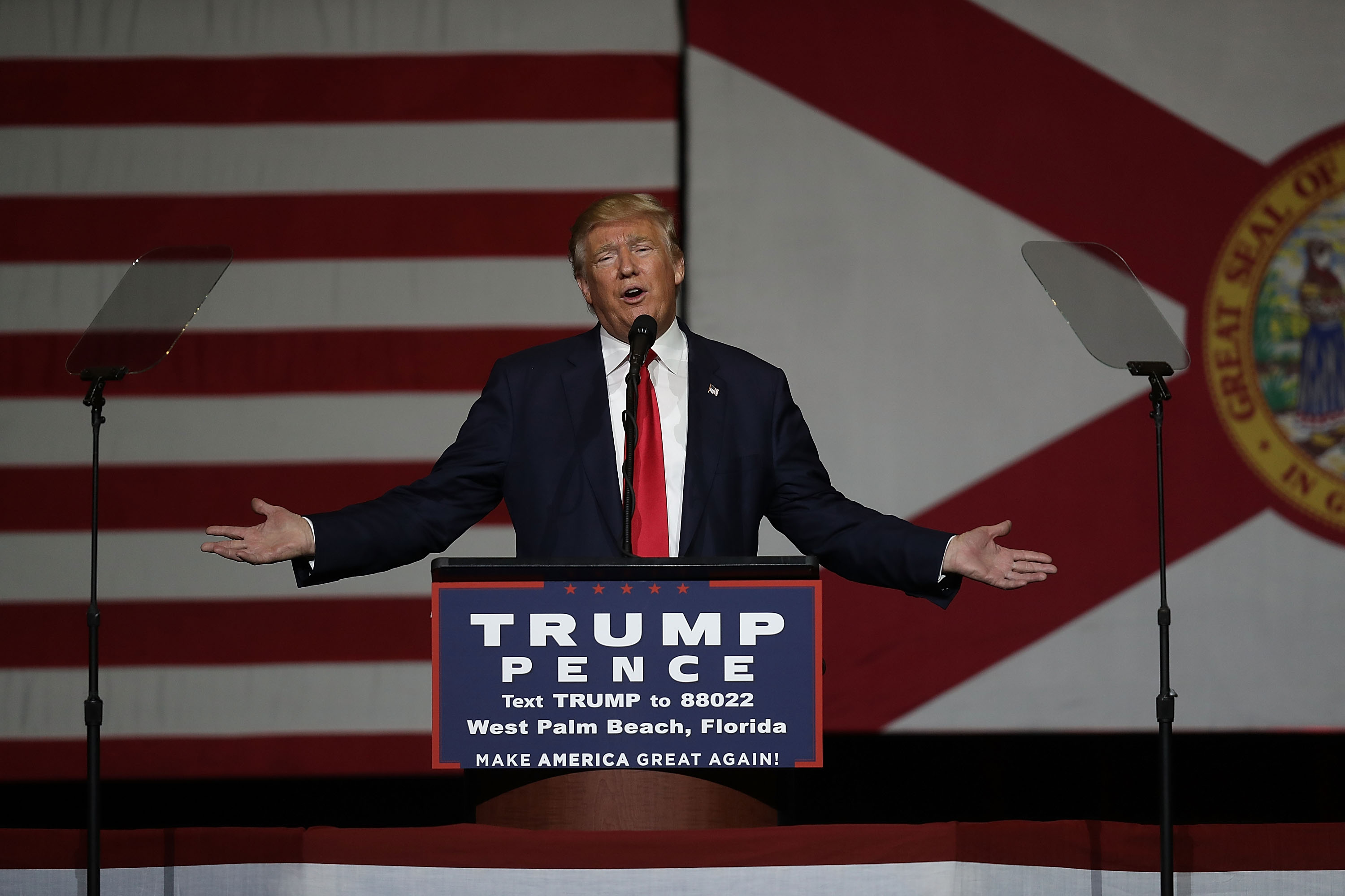 """WEST PALM BEACH, FL - OCTOBER 13: Republican presidential candidate Donald Trump speaks during a campaign rally at the South Florida Fair Expo Center on October 13, 2016 in West Palm Beach, Florida. In his remarks Trump vehemently denied recent allegations of past sexual assault and railed against mainstream media corruption and the """"Clinton machine"""". Joe Raedle/Getty Images/AFP"""