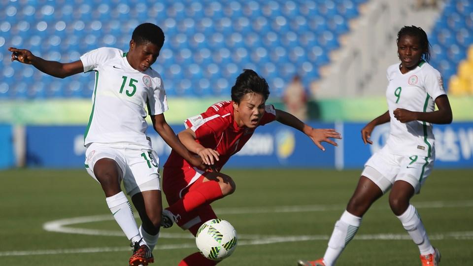 Kyong Hui Ko of Korea DPR is tackled by Opeyemi Sunday of Nigeria. PHOTO: FIFA