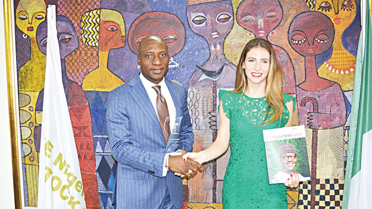 Chief Executive Officer, Nigerian Stock Exchange (NSE); Oscar Onyema (left) and Country Manager Nigeria, The Business Year magazine; Andrea Bernaldo de Quiros at the presentation of the 'Most Innovative Stock Exchange in Africa' award 2016 to NSE in Lagos.