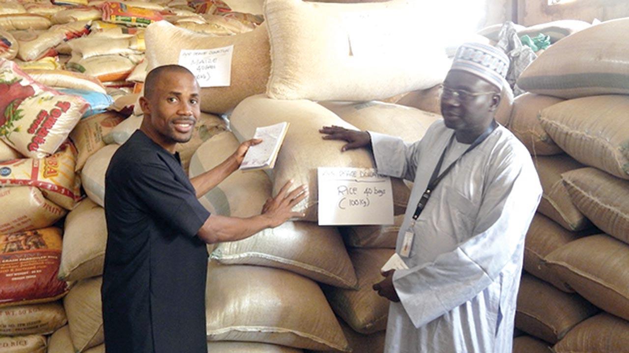 Corporate Communications Manager, Air Peace, Chris Iwarah (left) presenting relief materials to Jidawa in Damaturu…