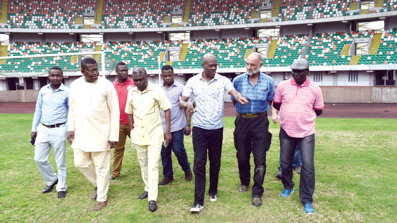 NFF Deputy Secretary General, Dr. Emmanuel Ikpeme (third right), explaining some points to the contractors when the federation inspected the Godswill Akpabio International Stadium…at the weekend.