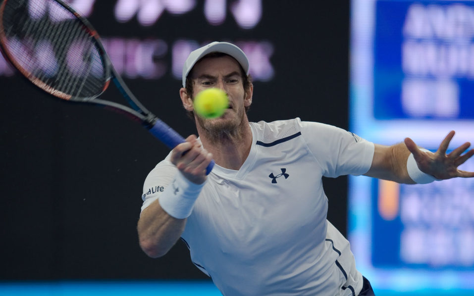 Andy Murray of Britain hits a return to Andrey Kuznetsov of Russia during the men's single second round of the China Open tennis tournament in Beijing on October 5, 2016.  Murray won 6-2 6-1. / AFP PHOTO / NICOLAS ASFOURI