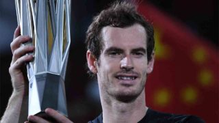 Andy Murray of Britain holds his trophy after winning his men's singles finals match against Roberto Bautista Agut of Spain at the Shanghai Masters tennis tournament in Shanghai on October 16, 2016 / AFP PHOTO / JOHANNES EISELE