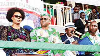 Wife of Ekiti State Governor, Feyisetan Fayose (left); her husband, Ayodele Fayose; Founder, ABUAD University, Afe Babalola and Chairman, state chapter of Nigeria Union of Teachers (NUT), Kayode Akosile, during the celebration of 2016 World Teachers' Day at Oluyemi Kayode Stadium in Ado-Ekiti… yesterday.