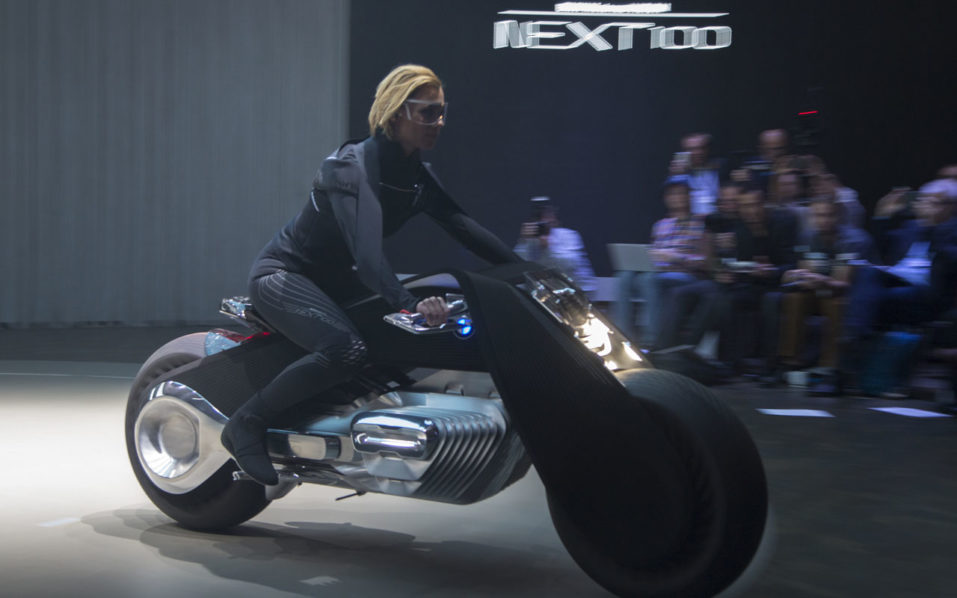 The BMW Motorrad VISION NEXT 100 concept motorcycle is unveiled on the last of four international stops of the Iconic Impulses event, recognizing 100 years of BMW, on October 11, 2016 in Santa Monica, California. / AFP PHOTO / DAVID MCNEW