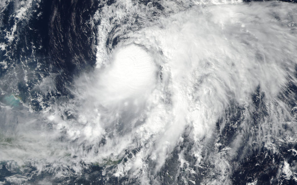 This October 9, 2016 NASA handout image shows Tropical Storm Nicole (15L) in the western Atlantic. Tropical Storm Nicole could become a hurricane for a second time and threaten Bermuda this week, according to the National Hurricane Center, which was tracking the storm in the central Atlantic on October 10. As of the last advisory, at 4 a.m. CDT October 10, Tropical Storm Nicole was located about 505 miles(813km) south of Bermuda and was moving north at 7 mph(11kph). Nicole had winds of 65 mph(104kph), unchanged from October 9. Hurricane force winds begin at 74 mph(119kph), and the hurricane center thinks Nicole will begin to strengthen more tonight and reach that mark by October 11. The hurricane center's official forecast path takes Nicole to the north and eventually northeast, which will take it very close to Bermuda, possibly by October 13. / AFP PHOTO / NASA / HO /