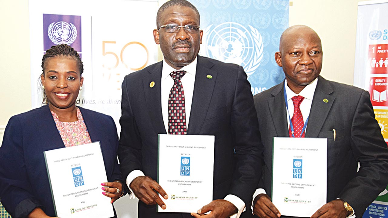 Acting Resident Representatives, United Nations Development Programme (UNDP), Mandisa Mashologu (left); Acting Managing Director, Bank of Industry (BOI), Waheed Olagunju, and Divisional Head (Large Enterprise) BOI, Joseph Babatunde, during the partnership agreement-execution ceremony between BoI, and UNDP on provision of Solar Energy, in Abuja.