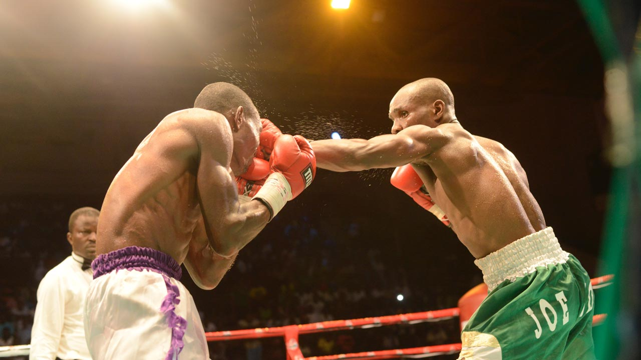 """Nigeria's Joe Boy lands a blow on Ghana's Richard """"Desert Warrior"""" Amefu, whom he defeated via a unanimous decision in an eight round international challenge contest at the GOtv Boxing Night 9 held at the National Stadium, Lagos…at the weekend."""